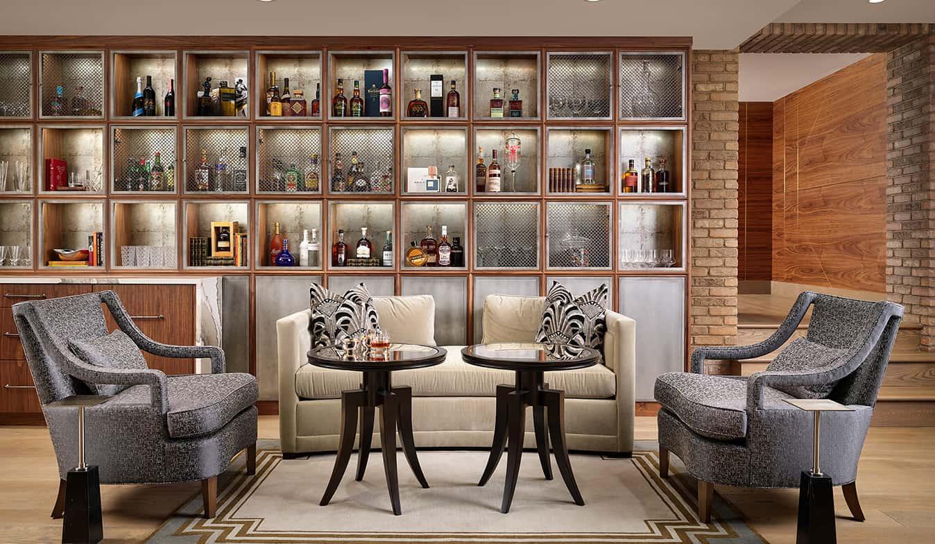 Custom full speakeasy basement bar and movie theater hero